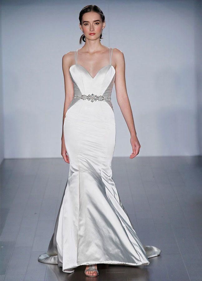 A touch of silk adds to an elegant, formal bridal look. These 21 classic silk wedding dresses blended with crepe, chiffon, or satin are some of the season's most beautiful options for less casual attire. The best time to wear silk? Well, whenever you want! Yet, some brides keep it classy with this shinier fabric after 5 o'clock. But hey, it's your day. See below for some of our favorite silky wedding dresses!