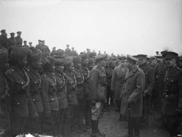 King George V inspecting Indian troops attached to the Royal Garrison Artillery, at Le Cateau on 2 December 1918.