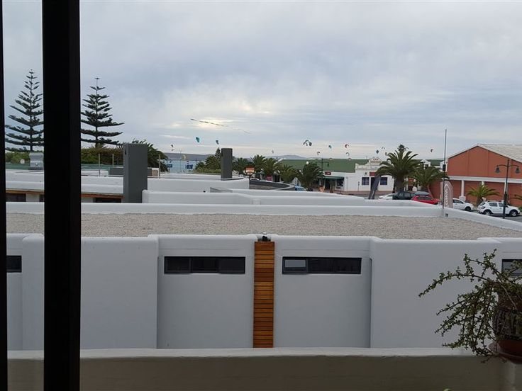 31 Madriko - This spacious two-bedroom apartment situated in Langebaan town centre 2 minutes' walk from the main beach, supermarket, popular restaurants and shops. The apartment boasts a balcony with barbeque facilities ... #weekendgetaways #langebaan #westcoast #southafrica