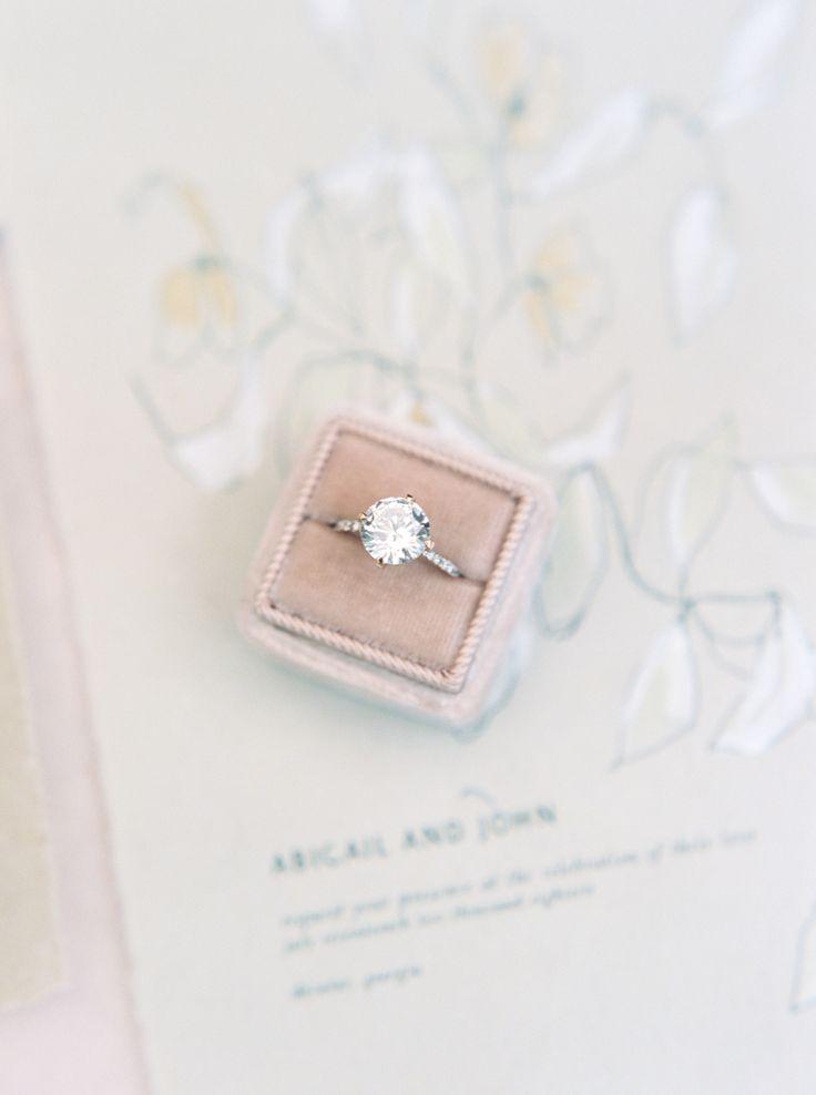 solitaire platinum diamond engagement ring pink velvet box | Photography: Abigail Malone