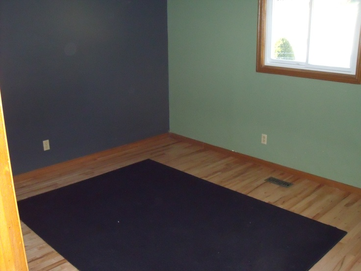 Master Bedroom with large three door closet and hardwood floors