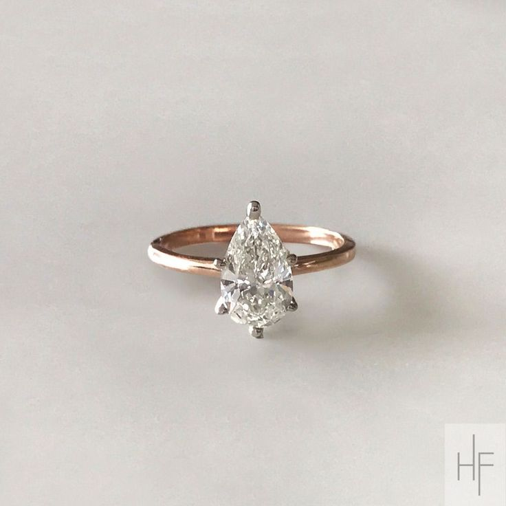 Pear cut diamond engagement ring. Classic and timeless design. Rose gold shank with white prongs. The rose gold gives it a warmer and unique look, and makes the white color of the diamond really pop. The white prongs (versus rose gold) ensure the diamond does not pick up on any yellow tones from the rose gold. By Hannah Florman Private Jeweler. Bridal and Custom Diamond Jewelry.