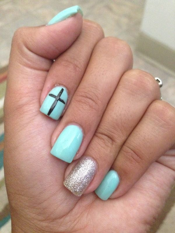 Teal nails with accent cross and silver nail. Normally not a fan of such girly nails but this is cute. Love the color.