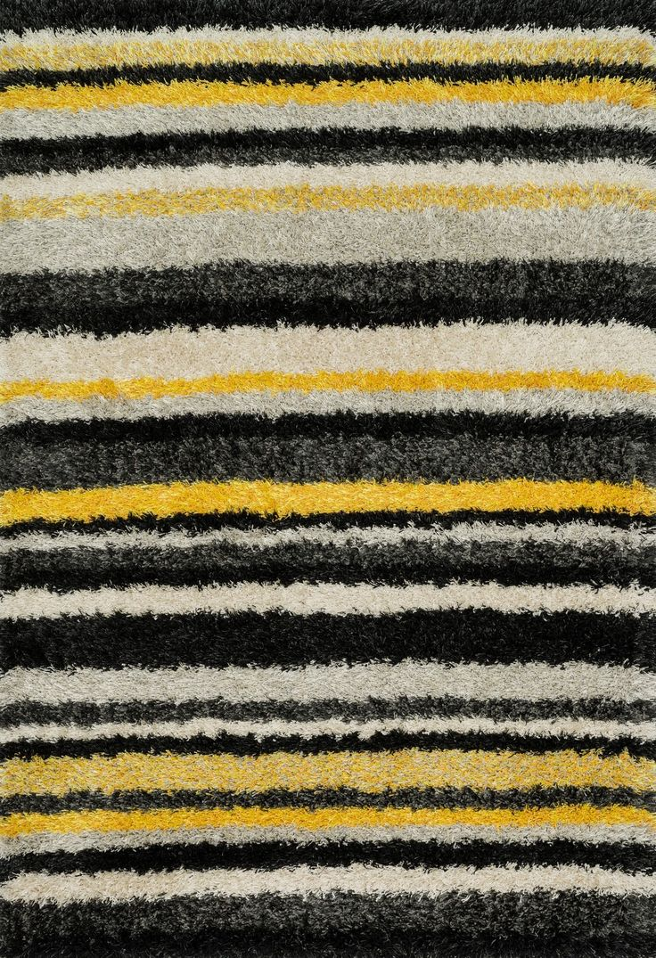 A room with a point of view; that's what you get with this Cosma Shag. Power-loomed in Egypt of polypropylene and polyester, this area rug's stripes are the perfect complement to any decor. Available at Rug & Home! #stripes #yellow #multi