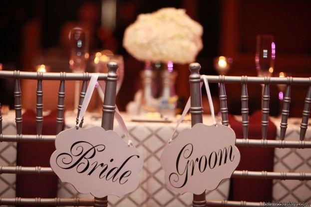 Hammock Beach Resort: Elisa and Rich | Silver Chiavari Chairs with blush pink Bride and Groom #wedding signage.