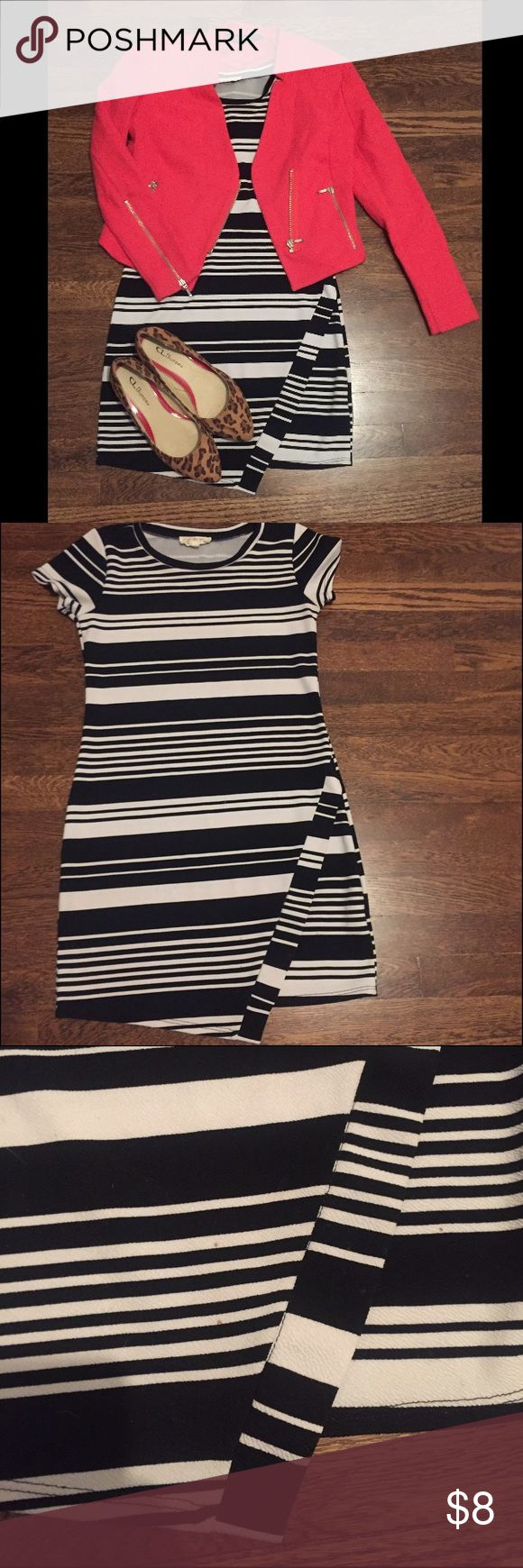 Black and white striped envelope dress- Sz M You don't have to spend a ton of money to be stylish! This black and white envelope style dress is perfect for a night out! There is a time stain near the bottom of the dress- priced to reflect that. Dresses Mini
