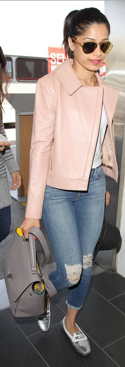 Frieda Pinto's pink leather jacket, silver flat shoes, ripped blue skinny jeans, and aviator sunglasses