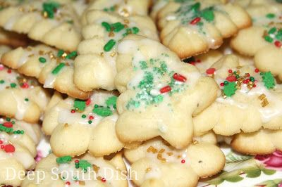 Classic Butter Spritz Cookies - A classic butter cookie made using a cookie press, lightly glazed and decorated with sprinkles, candied cherry halves and nonpareils.
