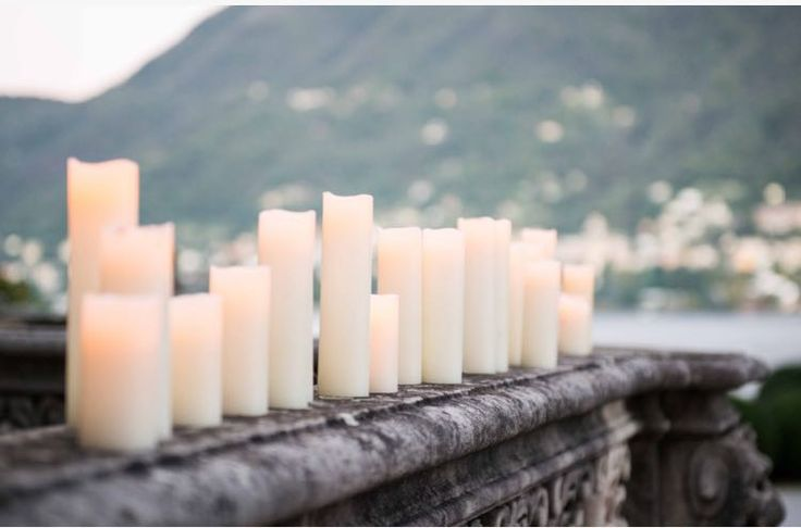white candles and landscape