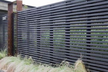 Wittman Estes Architecture + Landscape Horizontal black timber batten screen with corten gate. Pinned to Garden Design - Walls, Fences and Screens by Darin Bradbury.