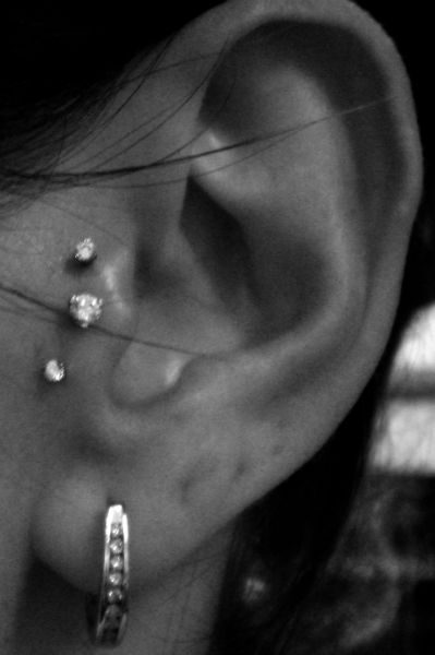 this looks badass but i would not be willing to endure the pain of 2 additional tragus piericings in the same ear. maybe one day?