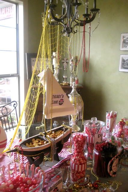 pirate party inspiration -- hanging netting and beads from the light fixture