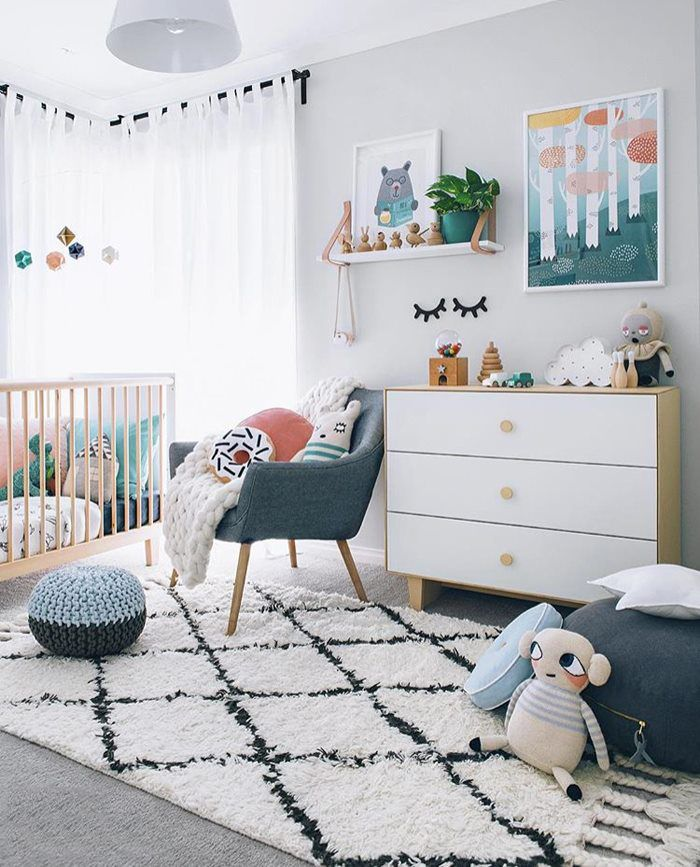 Gorgeous texture to this calm and neutral kids' room through layering and a stunning Berber rug.