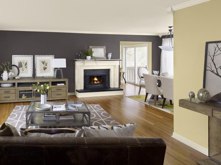One reason an accent wall can work great in a living room is that it can tie to separate living spaces together, as this one does between the living room and the kitchen beyond.