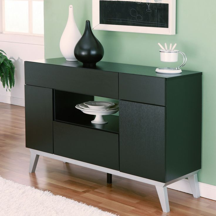 The Miura Modern Multi-storage Black Buffet Table is the perfect art piece to any dining decor. With a striking silver finish, the table offers ample storage settings and tapered feet supports which offer slight modern elevation.