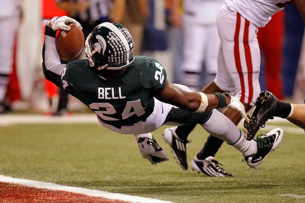 Le'Veon Bell #24 of the Michigan State Spartans scores a 6-yard rushing touchdown against the Wisconsin Badgers during the second quarter of the Big 10 Conference Championship Game at Lucas Oil Stadium on December 3, 2011 in Indianapolis, Indiana.