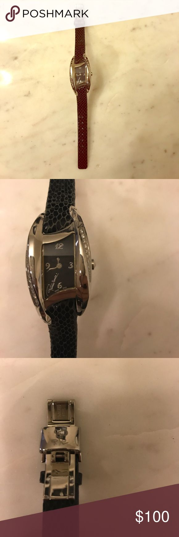 NWT ROBERTO CAVALLI SNAKESKIN CRYSTAL WATCH. Roberto Cavalli snakeskin crystal watch. Beautiful black band with crystals on both sides of the face. Needs a battery. Really luxurious piece. Roberto Cavalli Accessories Watches