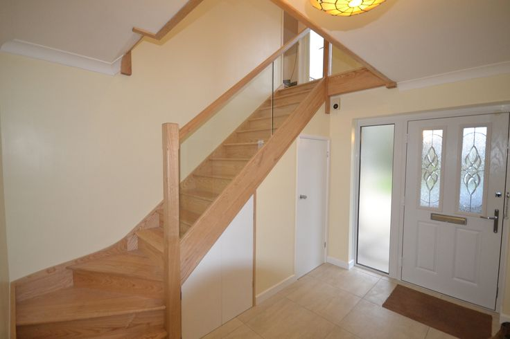 Bespoke staircase with sophisticated glass balustrade - the ideal finishing touch.