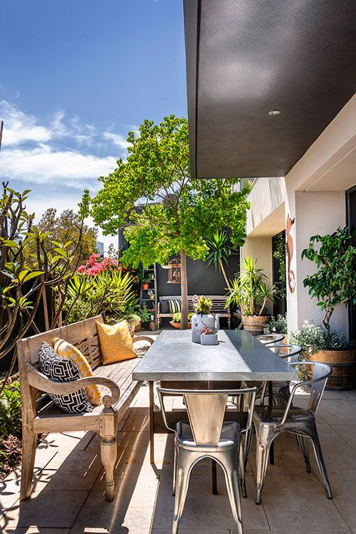 Love this look.  #outdoor #patio #dining #industrial #wooden