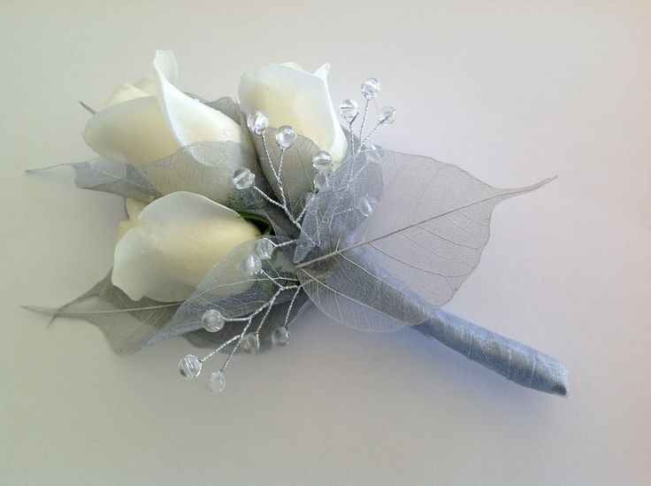 silver and white with crystal stems an elegant young mans buttonhole