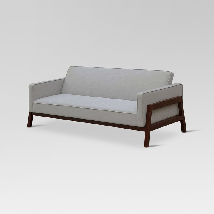 Whether you're looking to update your current living space or you need a way to conveniently have guests spend the night, you'll love the Wood Frame Convertible Sofa from Threshold™. This sofa comes in a neutral shade of light gray with brown wooden legs that give off a modern feel to your space. For movie nights, game nights or casual hangouts, use it traditionally as a sofa. When you have guests in town, fold the backrest down flat so they have a comfortable space to sleep....