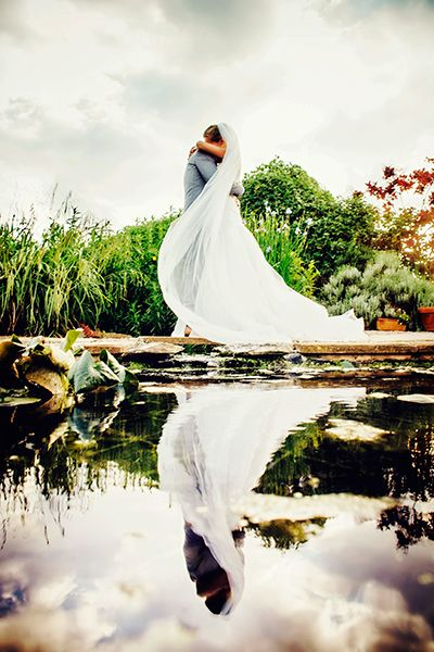 We're seeing double in this stunning reflection, mirroring not just the beauty of nature but that of the embrace between bride and groom.