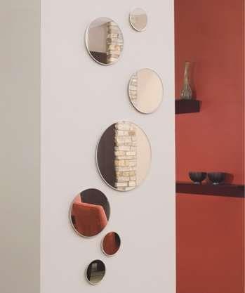 mirrors on wall   Zoe Circle Wall Mirror Set   Apartment Therapy