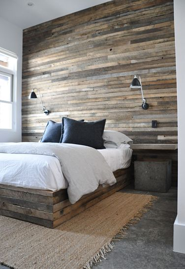 all about texture: jute rug, reclaimed wood wall, soft fluffy down duvet cover. soft and neutral. love the swing-arm sconces for reading in bed.