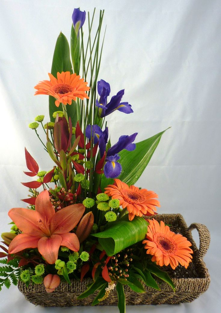 _basket_arrangement_aurora Lovely Arrangement Of Lilies, Gerbra Daisies,  Iris And It Looks Like Green Button Mums Beautiful Shape And Style