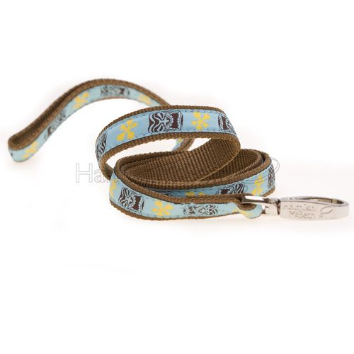 The Hamish McBeth swimmables leashes are ideal for walks on the beach, or on rainy days. These leashes are sturdy and made to last, because only good quality materials won't fray or break at the first sign of tension. The clip and spring are both rustproof, and the bold, bright design matches the same collar in the swimmables range. Yellow and brown tiki on blue background. #dogleash #doglead #leash #lead