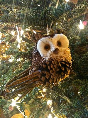 Owl tree ornament made from a pine cone.