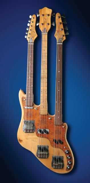 Triple-neck Wal bass designed by Rick Wakeman for Chris Squire.  The bottom neck is fretless, the middle neck is a regular bass, and the top neck is a six-string Telecaster-style guitar that Squire refitted as a 3 double-string octave bass (tuned AA-DD-GG; http://blog.hardrock.com/?tag=/squire+cheap+trick#).  It's on display at Hard Rock Cafe Bucharest.