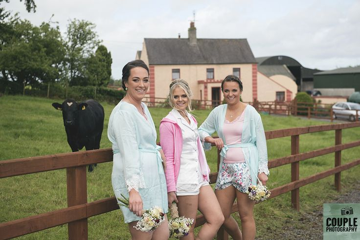 The bride & her bridesmaids (and a cow!) outside the farmhouse where she grew up. Wedding at Summerhill House Hotel by Couple Photography.