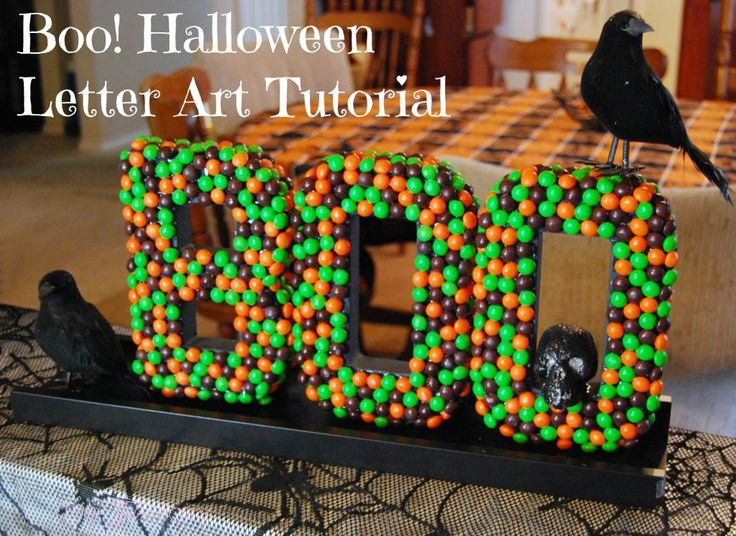 Boo! Come see how easy this Halloween Letter Art is using Skittles candies! Make it for the mantel, centerpiece, or as wall art!