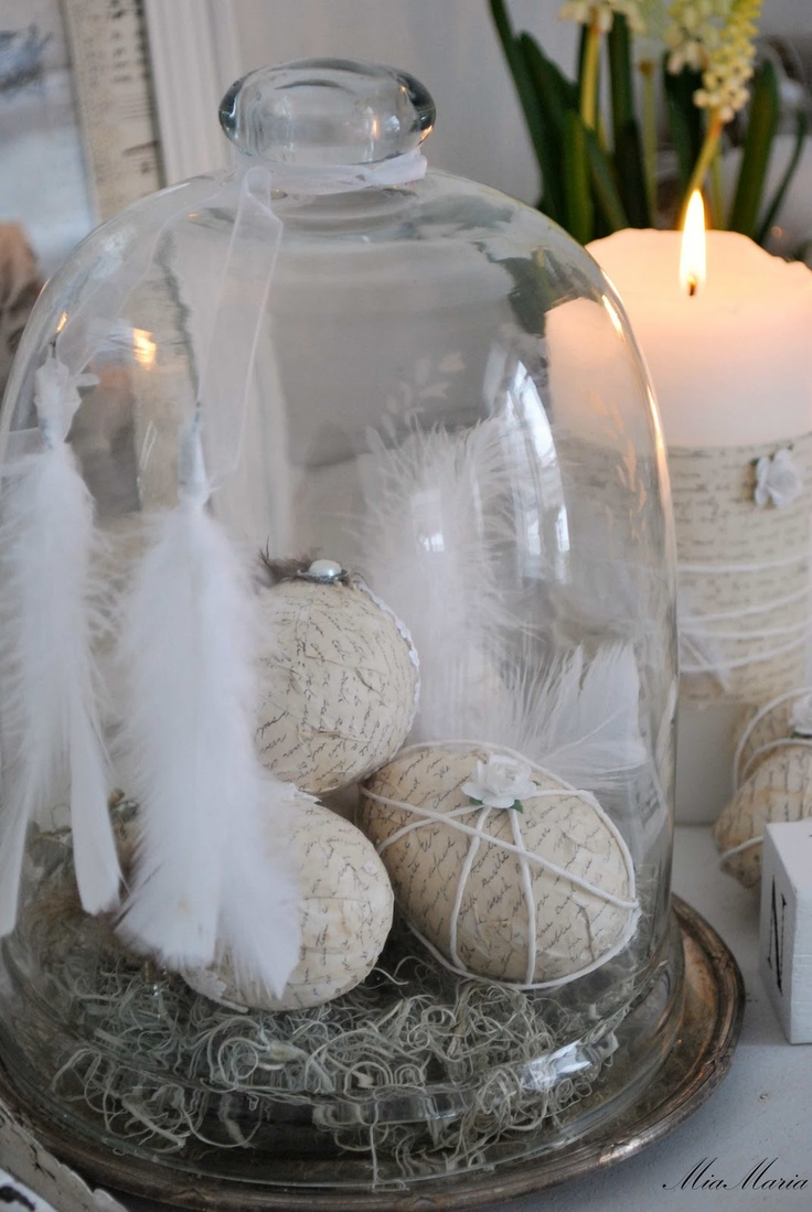 Easter Cloche..paper covered eggs, white feathers...love this.