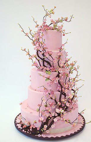 I never thought I'd want a tree to grow out of a wedding cake...now I do.