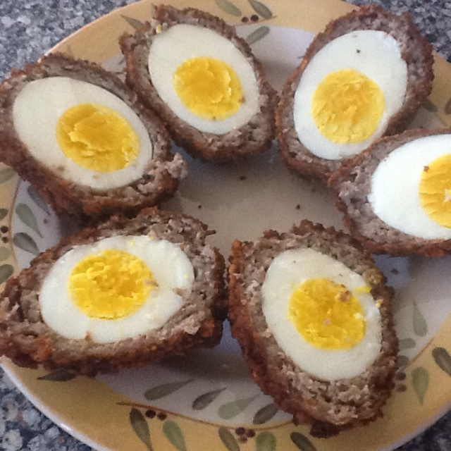 Scotch eggs- hard boiled egg wrapped in breakfast sausage, egg and ...