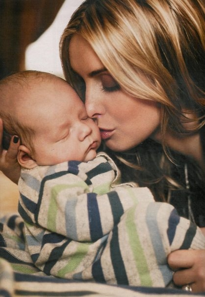 Louise Redknapp doing a Hello Magazine shoot with gorgeous newborn Beau Henry, modelling our Cuddle Me Cashmere playsuit.