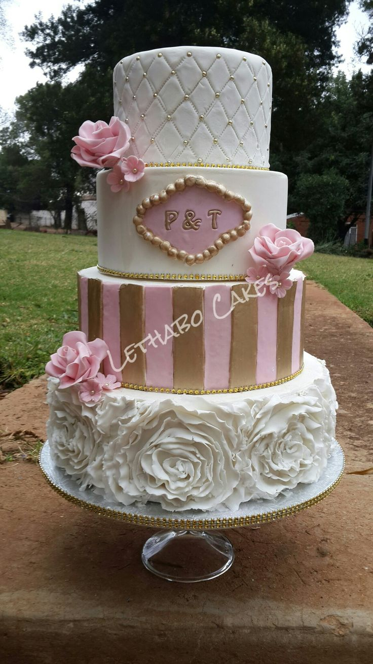 Pink, white and gold 4 tier with roses, ruffles and quilting