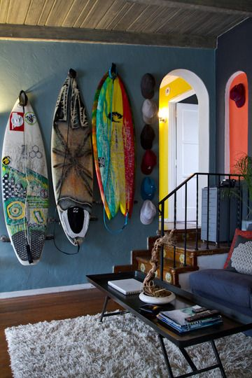 Surf boards as art--awesome way to store and show off.