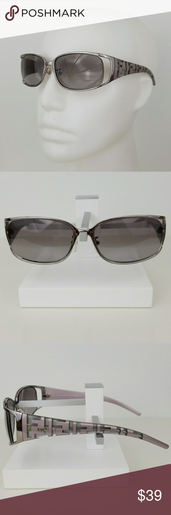 FENDI FS345 Eyeglass Frames Gunmetal grey face with floating lens. Polycarbonate side arms in metallic lavender with clear Fending logo initial print. Made in Italy. 58 16 130. These currently contain prescription lenses that must be changed to your personal RX lens and adjusted by your fave optician. Good used shape with minor surface scratching and minor blemishes. Some tarnishing of the wire that is encased in the side arm polycarbonate (visible green patina). Price reflects wear. These…