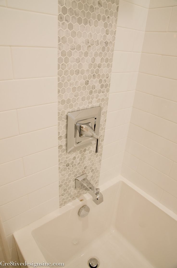 Marble Accent Tile In Strip Along Shower Head, Inset Shelves, Shower Floor,  Subway Tile On Walls