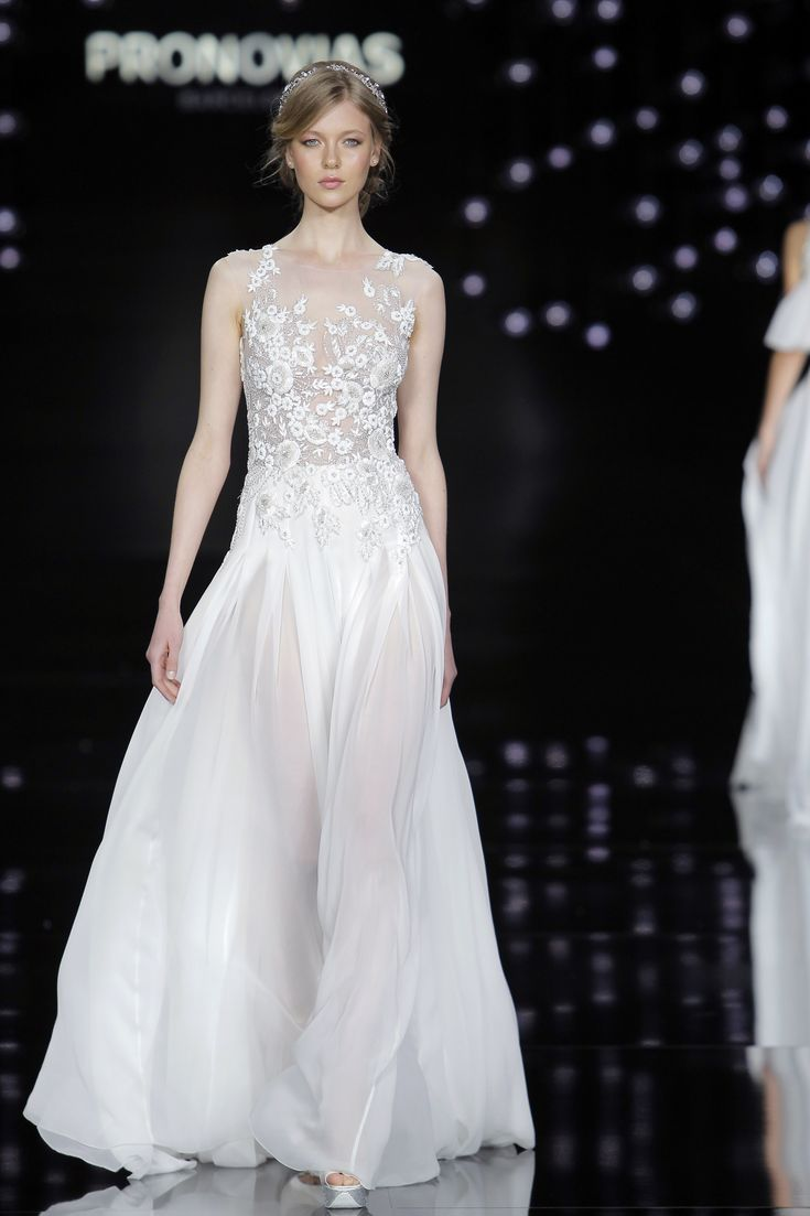 Katya Ledneva in Nadia dress made of silk chiffon, tulle and embroidery.