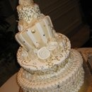 KTLA morning news shoot, by Reva Alexander-Hawk, Topsy Turvy Wedding cake with Swarovski crystal and hand painted gold accents.