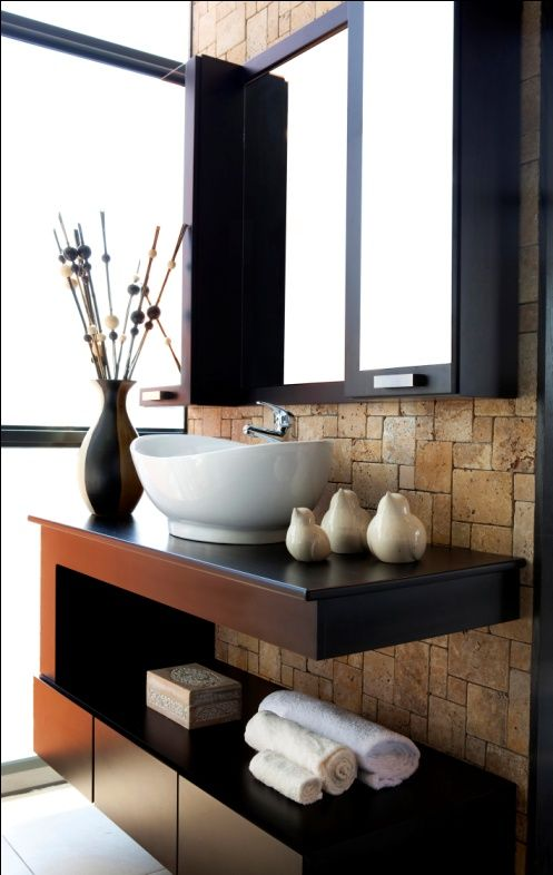 Sandstone cladding works well as a feature wall behind the vanity and mirror in the #bathroom