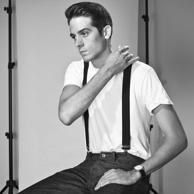 This is G-Eazy. He is a rapper. He dresses like he lives in the 1950's. His songs are: runaround sue, and his album is endless summer.
