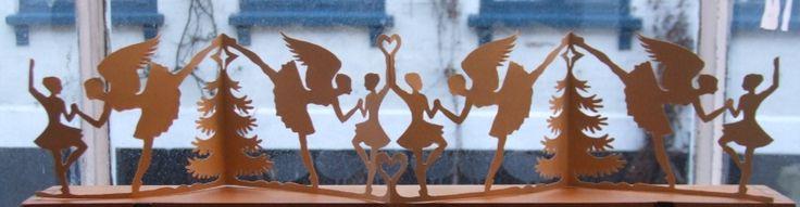 Juletræsdansere (means Christmas tree dancers) Papercut in beige. Hight ca. 10 cm. By Naja Abelsen