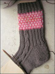 This cuff down sock, inspired by some of my favorite fantasy books, incorporates stranded knitting, cables, and ribbing for a comfortable fit.