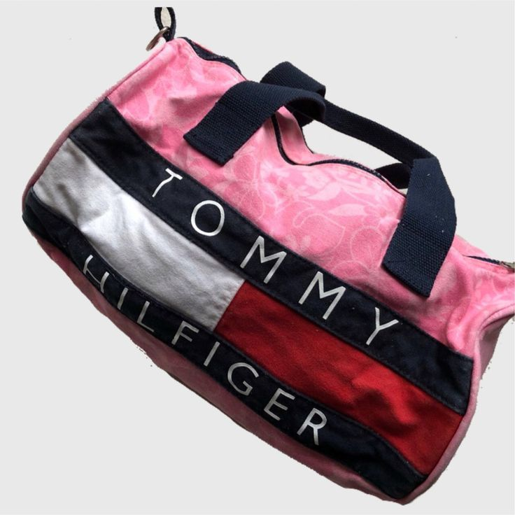 315b03d5f7dac Cute pink Tommy Hilfiger mini duffle bag/purse. Has a flower - Depop ...