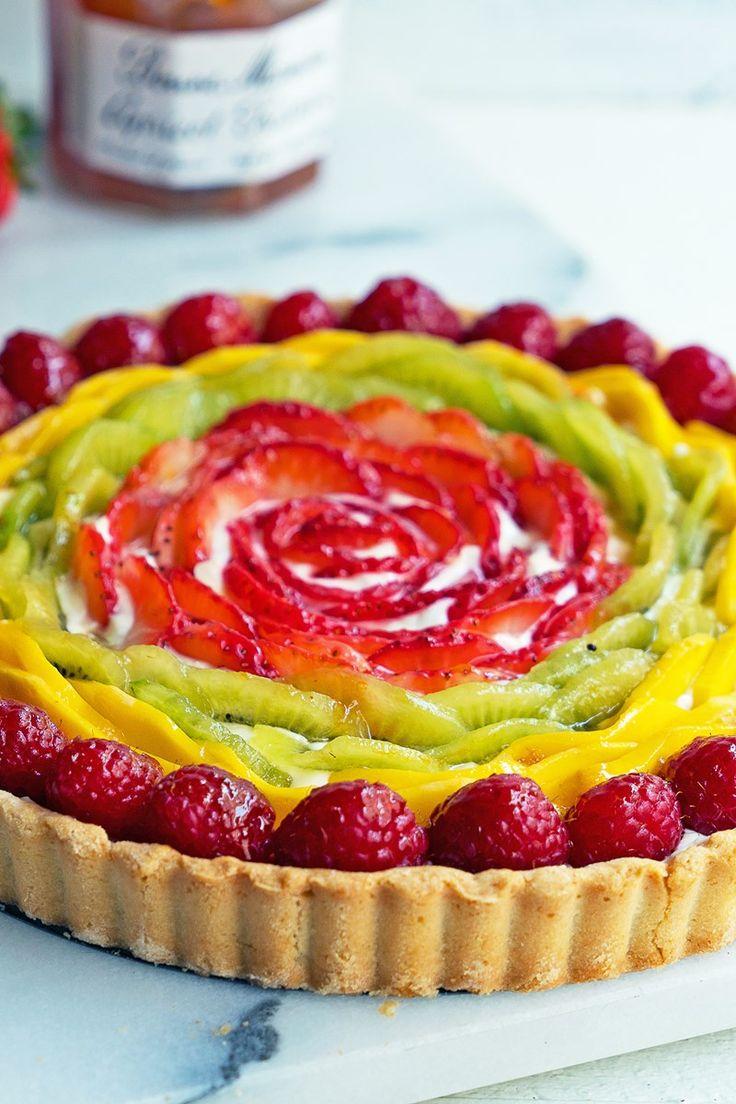 Recipe including course(s): Dessert; and ingredients: apricot preserves, cream cheese, egg, flour, kiwi, lemon zest, liqueur, mango, raspberries, strawberries, sugar, unsalted butter